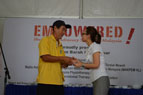 Dr Christina Ng thanking cancer survivor Mr Tan Chu Tea for sharing his testimony at the event