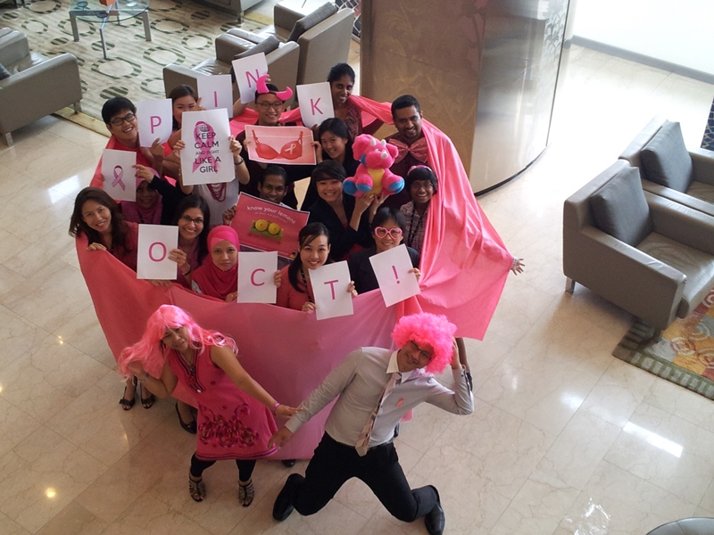 A team from Transactions showing off their pink tutus and wigs for EY's Pink October challenges
