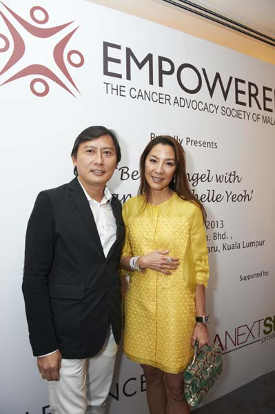 Yang Berbahagia Tan Sri Michelle Yeoh with an esteemed guest for a photo