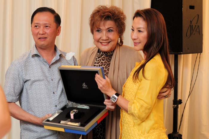 A successful bidder (1st from left) for a priceless timepiece, with the Yeoh family