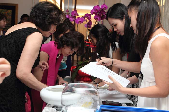EMPOWERED's volunteers and esteemed guests during the registration of 'Be an Angel with Tan Sri Michelle Yeoh'